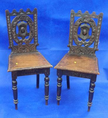 Two carved oak chairs