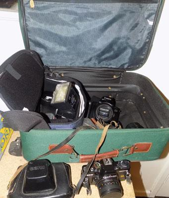 Large suitcase, cameras, lenses