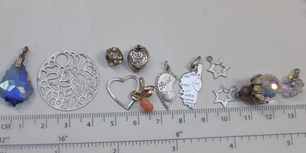 Selection of pendants & charms - some silver