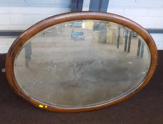 Large framed oval mirror with inlaid design