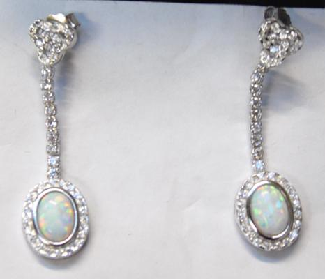Pair of silver & opal earrings