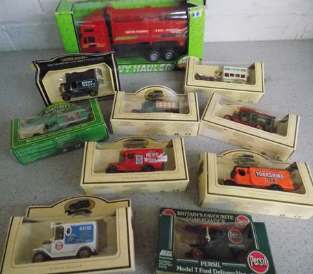 10 Boxed die cast cars & vans inc 1 large scale lorry