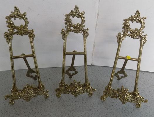 "Three unusual brass picture stands - 10"" high"