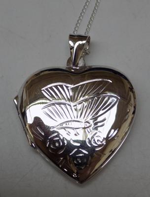 Silver heart locket on silver chain