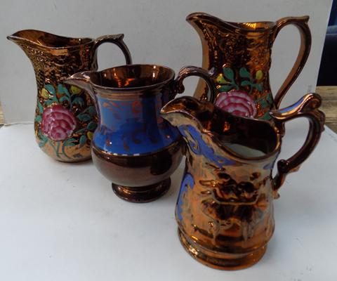 Four ornamental jugs