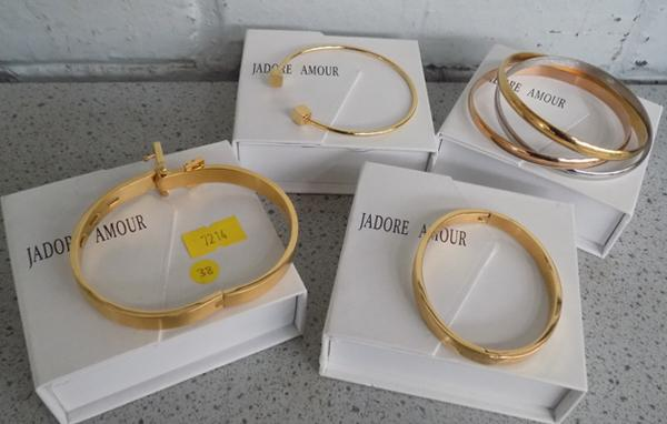 Four Amour bracelets - new in box