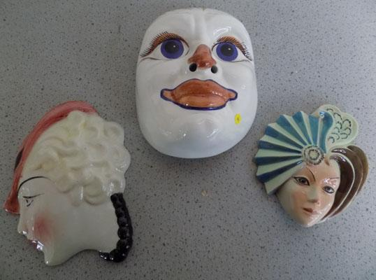 Three ceramic faces
