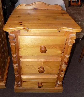 Three drawer pine bedside unit