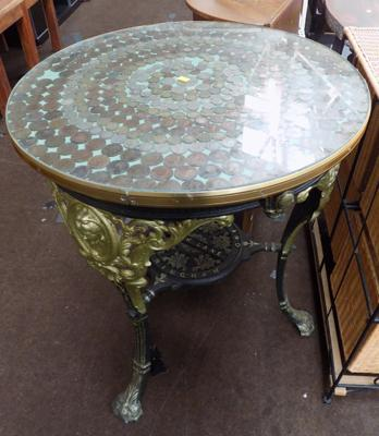 Cast iron table, coin topped - with local interest