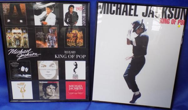 Two Michael Jackson posters in frames