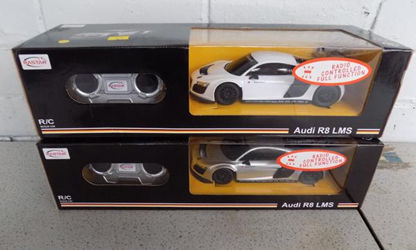 Two remote controlled Audi R8s in box