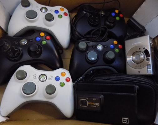 Box of gaming controllers and cameras