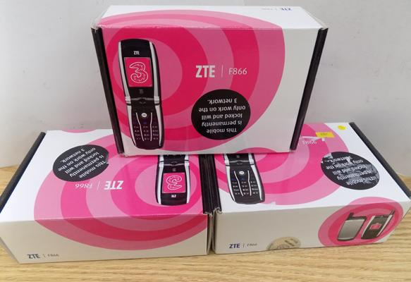 Three boxed mobile phones