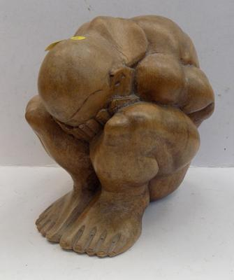 Figure of crying man carved in Yew wood 18cm high
