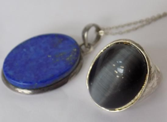 White metal ring & silver chain with blue pendant