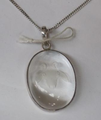 Silver Aries pendant on silver chain