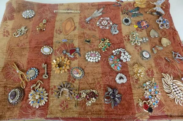 Large selection of brooches