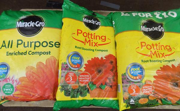 Three bags of Miracle Grow Compost