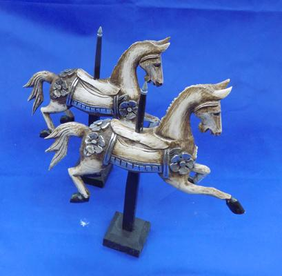 Two wooden decorative carousel horses