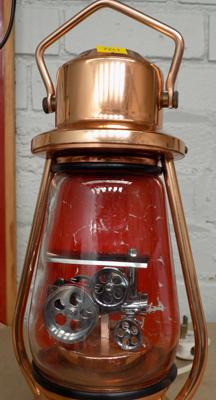 Copper lamp with moving traction engine