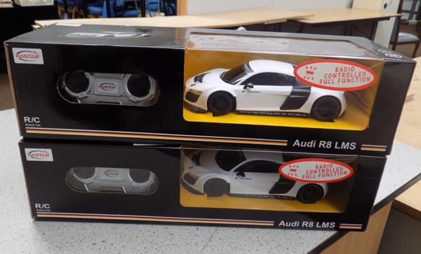 2x Remote control boxed racing cars