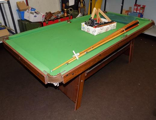 Small size snooker/pool table + two pool ball sets, one snooker ball set & various cues/rests