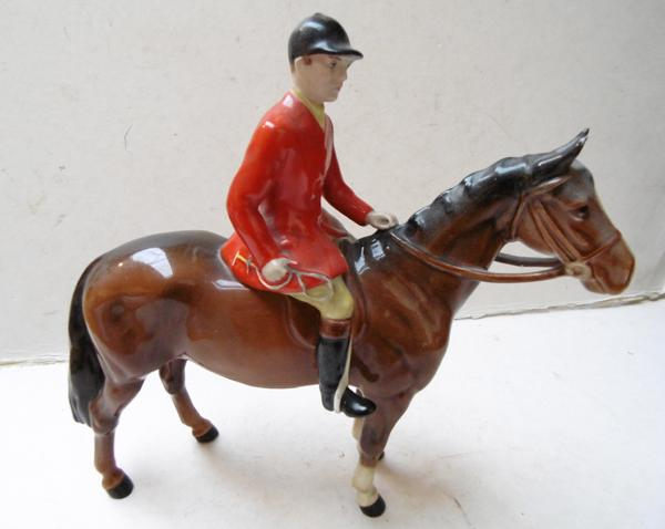 Beswick Huntsman mounted on horse-slight damage to reins