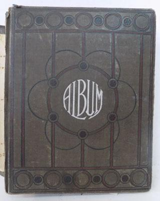Antique photo album containing many hand finished postcards