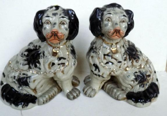 "Pair of Black & White fireside dogs. No damage found. Approx 10"" high"