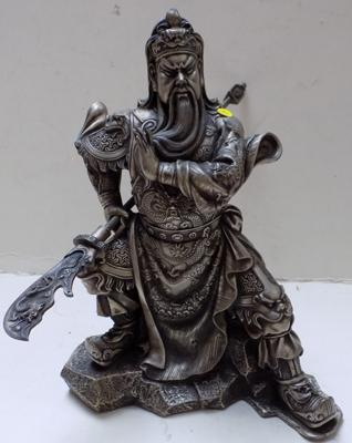 Ornate oriental figure