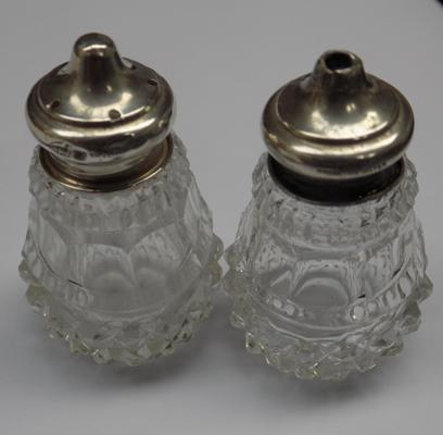Pair of sterling silver and cut glass salt and pepper pots - hallmarked sterling