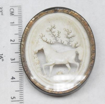 Vintage bone ' horse in forest' brooch