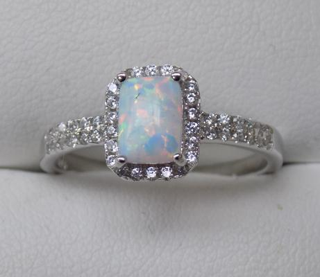 Silver and opal set ring