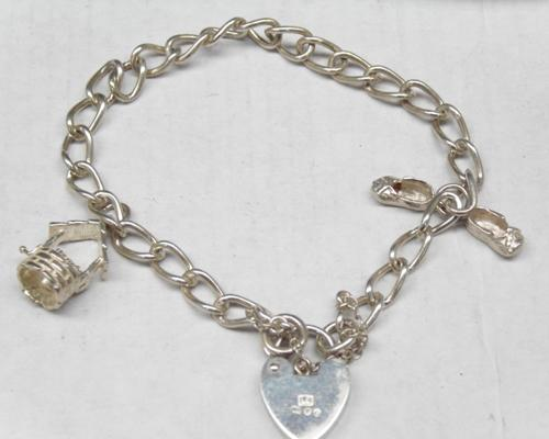 Vintage sterling silver charm bracelet with charms - London 1979