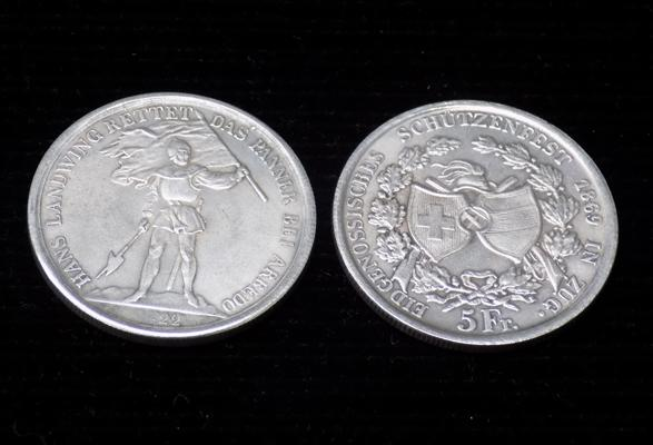 2 silver coloured coins