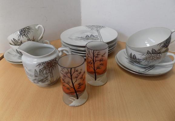 Japanese porcelain - 4 cups and saucers (ladies head in base of cups) 6 plates, 1 jug and 2 small glasses