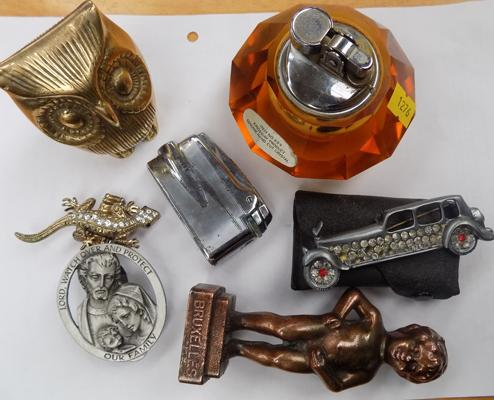 Selection of collectables including lighters and badges
