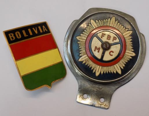 2 vintage car badges