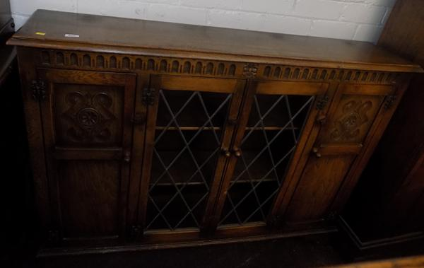Hand carved oak sideboard with leaded glass doors