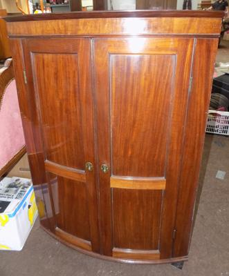 Bow front double door cabinet