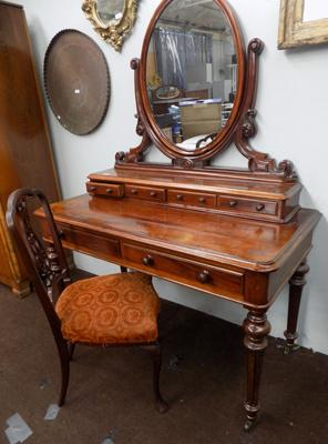 Mirrored back ornate dressing table and chair