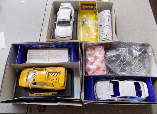 3 boxed Burago boxed model cars