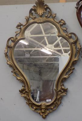 Ornate gold coloured mirror