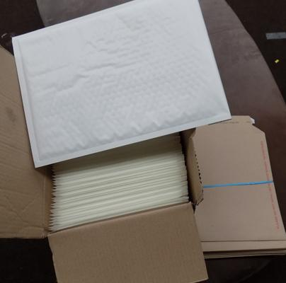 Box of bubble envelopes and pack of cardboard envelopes