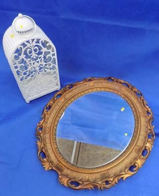 Oval mirror and candle lantern