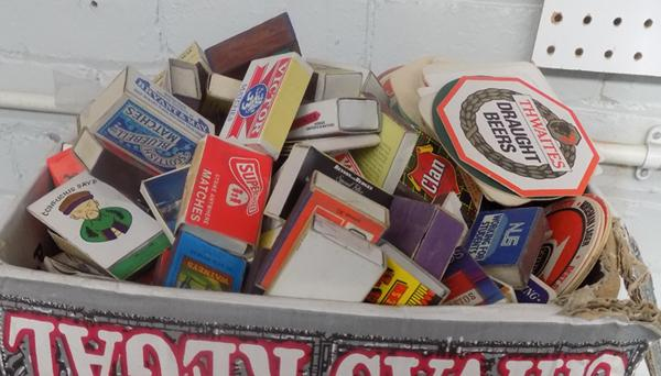 Large box of beer mats and match boxes