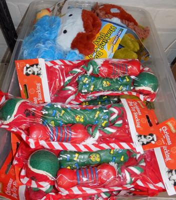 Large box of new dog toys and treats