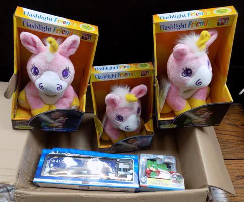 Box including 3 plush unicorns