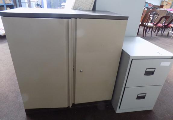 Small metal cupboard and large cupboard