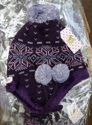 Large box of deep purple tottie knitters hats